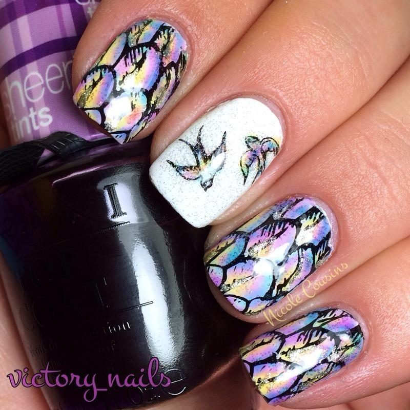 Pastel bird feathers nail art by Nicole