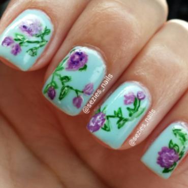 purple flowers nail art by Sarah Bellwood