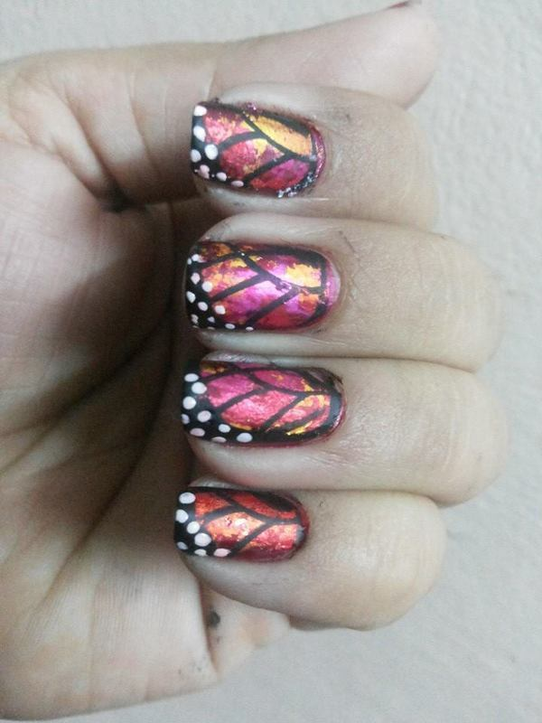 butter fly wings nail art by Uma mathur