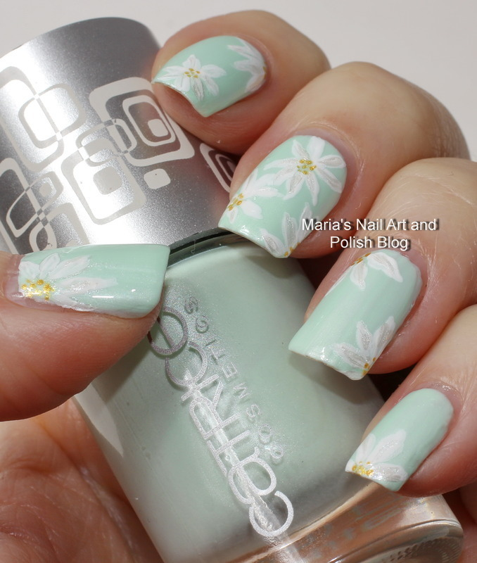 Subtle floral nail art on mint nail art by Maria