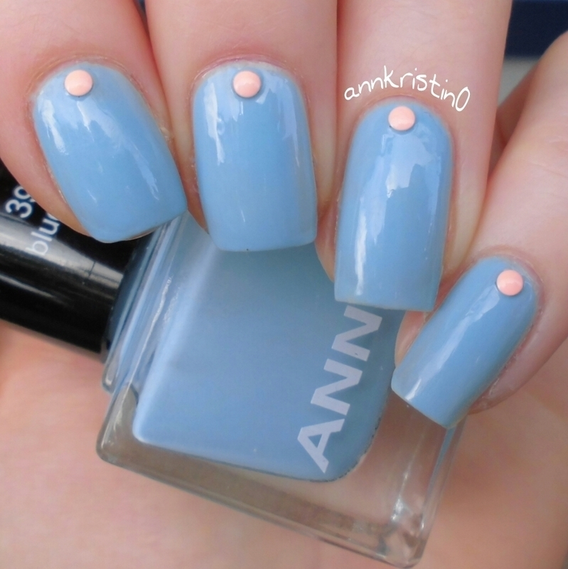 Light Blue and Neon Studs nail art by Ann-Kristin