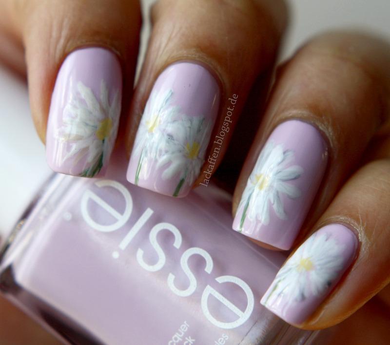 Daisy nail art by Tartelette
