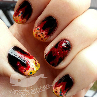 Hunger games fire nail art by Cachalot