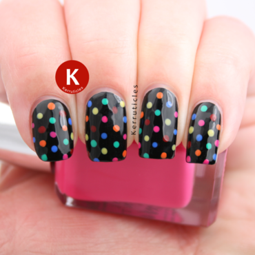 Multi-coloured polka dots on black nail art by Claire Kerr