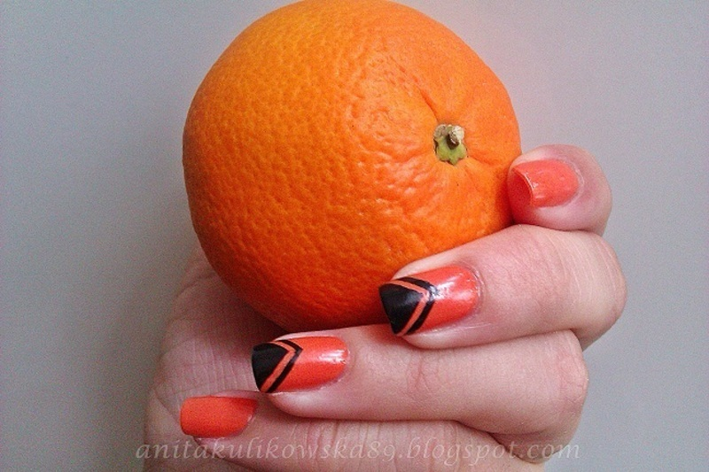 Oranges nails with black triangle nail art by Anita