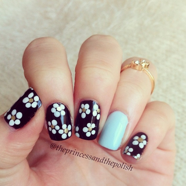 Monochrome Daisies with a pastel blue pop! nail art by Alexandra