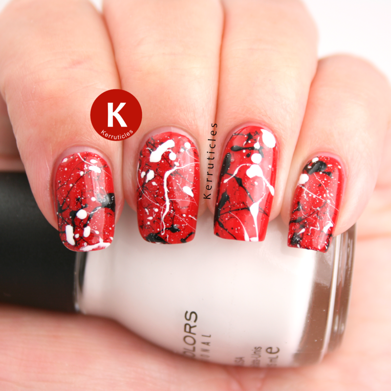 Red, black and white splatter nail art by Claire Kerr