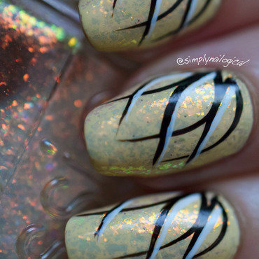 Flakie-topped looping effect nail art by simplynailogical
