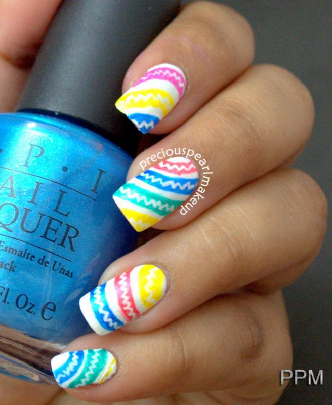 Rainbows nail art by Pearl P.
