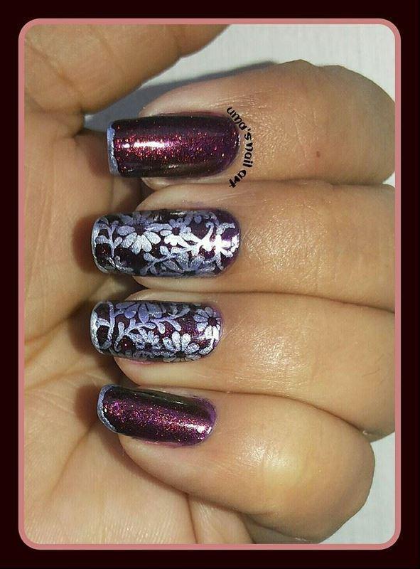 floral.. nail art by Uma mathur