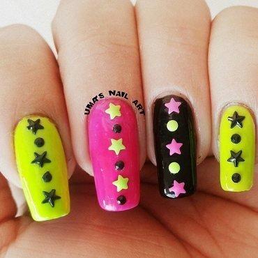 Neon stars nail art by Uma mathur