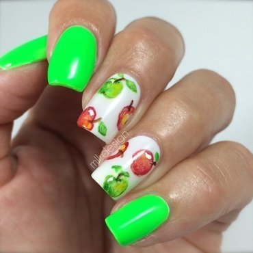 Neon green with watercolor apples nail art by Maja Sevelius