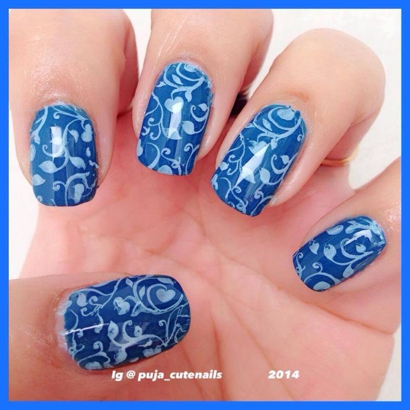 Blue on blue stamping nail art  nail art by Puja Malhotra