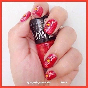 Red flower nail art nail art by Puja Malhotra
