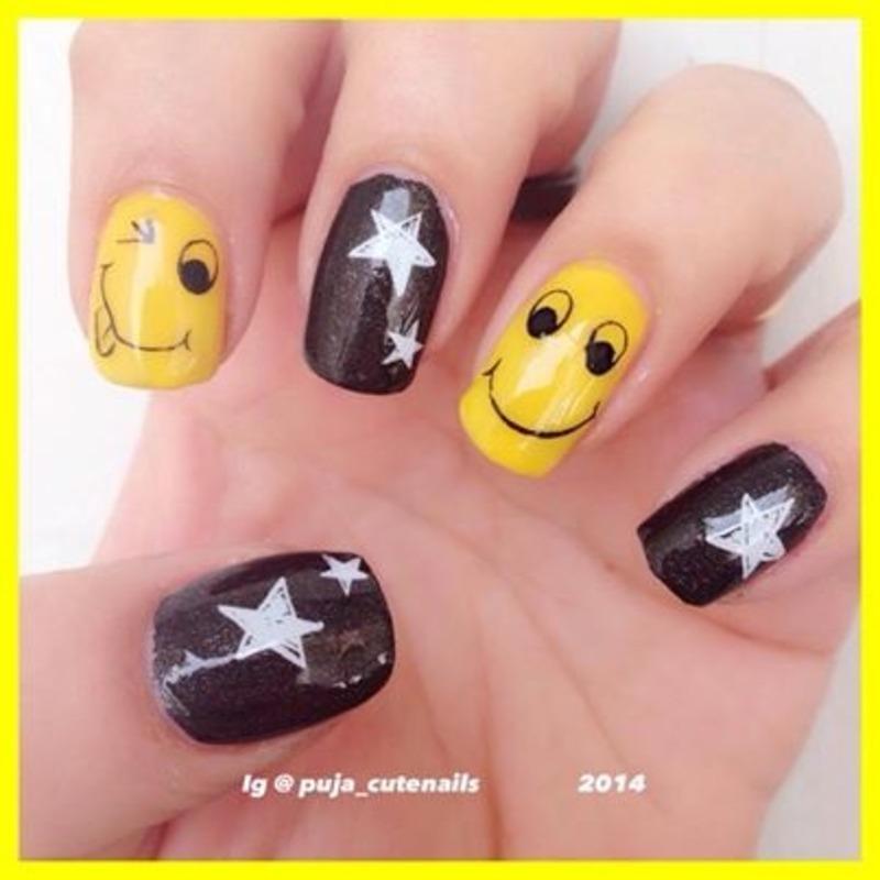 Smiley nail art nail art by Puja Malhotra