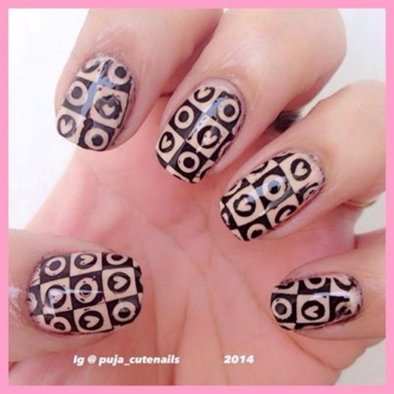 Heart and polka dot nails nail art by Puja Malhotra