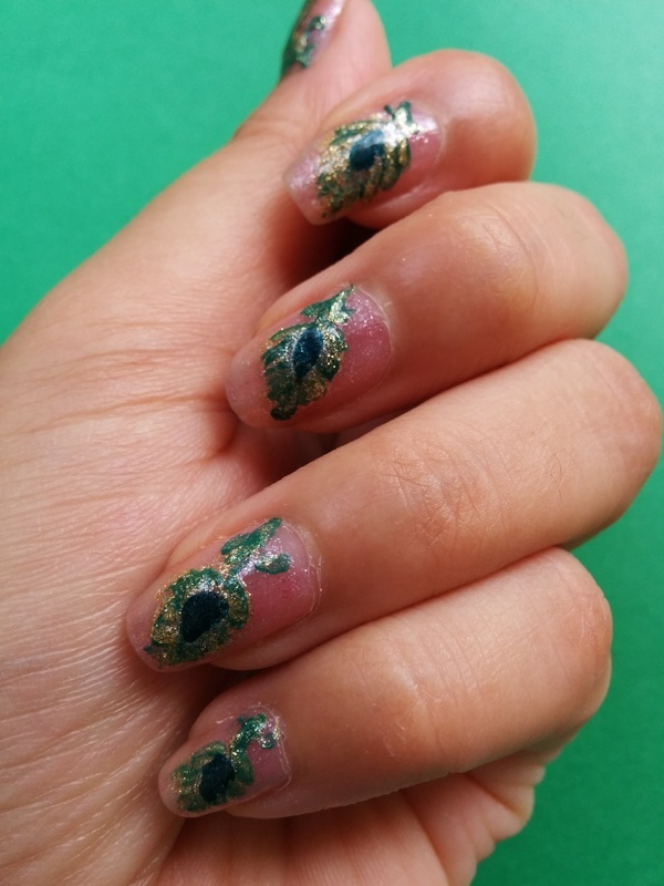 Green and gold feathers nail art by Haniya Sajid
