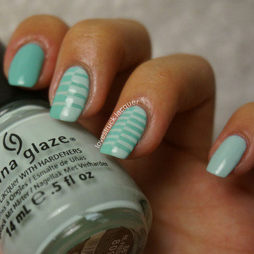 mint reverse stripes nail art by Stephanie L
