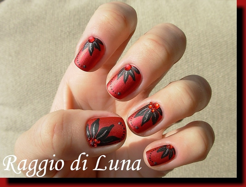 Black flower on red nail art by Tanja
