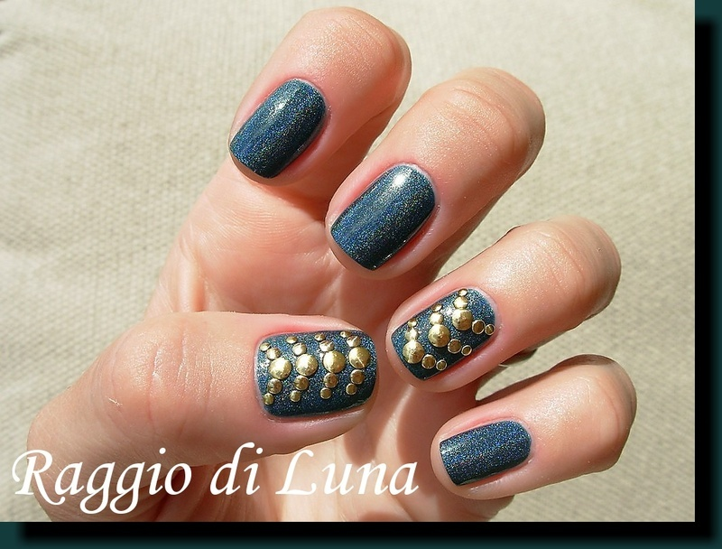 Golden and silver round nail art studs on green holo nail art by Tanja