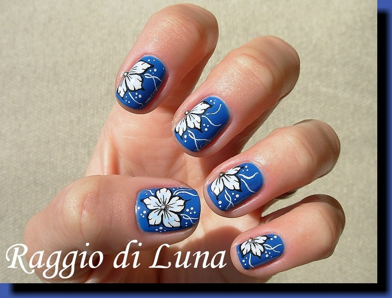White flower on blue nail art by Tanja