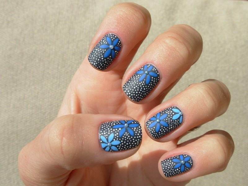 Blue flowers with dots on charcoal grey nail art by Tanja