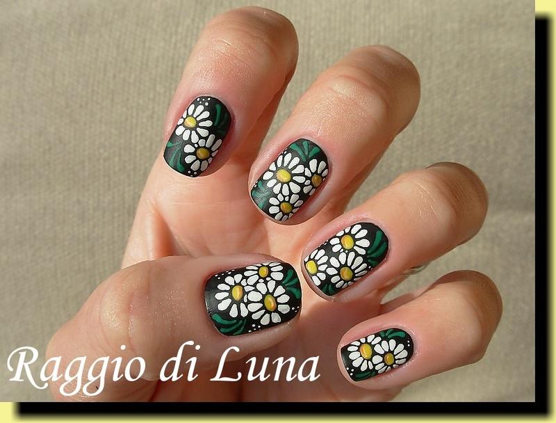 Daisies on black nail art by Tanja
