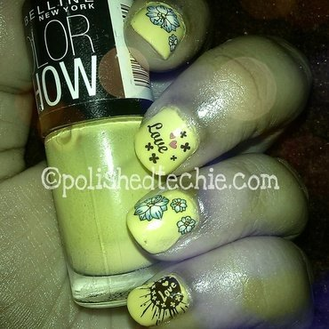 Yellow base with water decals nail art by Rajani Polished Techie