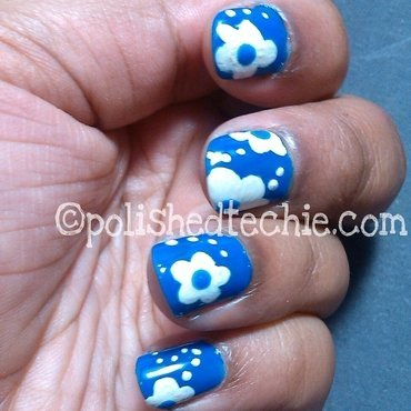 Blue with white floral Nailart nail art by Rajani Polished Techie