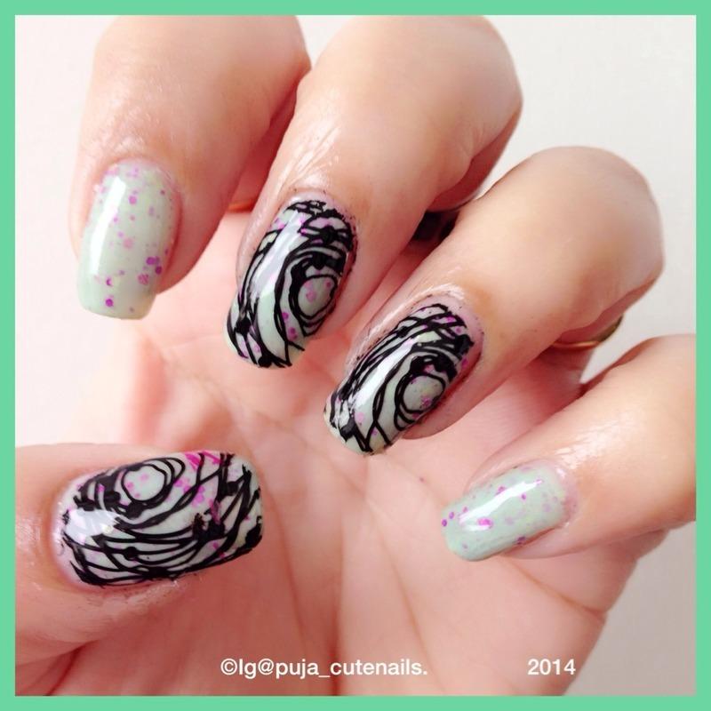 Thread spun nail art nail art by Puja Malhotra