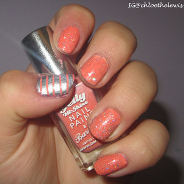 Pretty coral orange nails with silver stripes and glitter nail art by Chloe Lewis