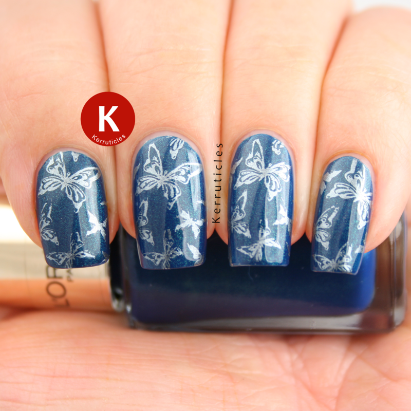 Blue stamped butterflies nail art by Claire Kerr