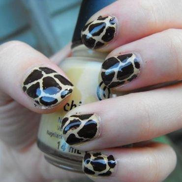 Giraffe Print nail art by faerietalenails