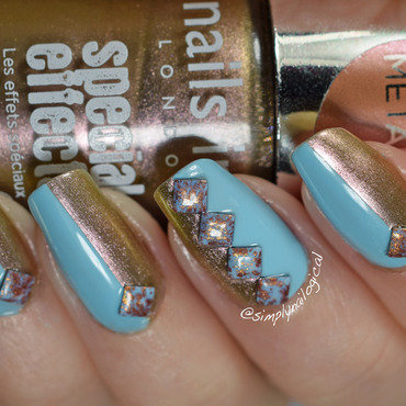 Split gold and blue with crackled studs nail art by simplynailogical