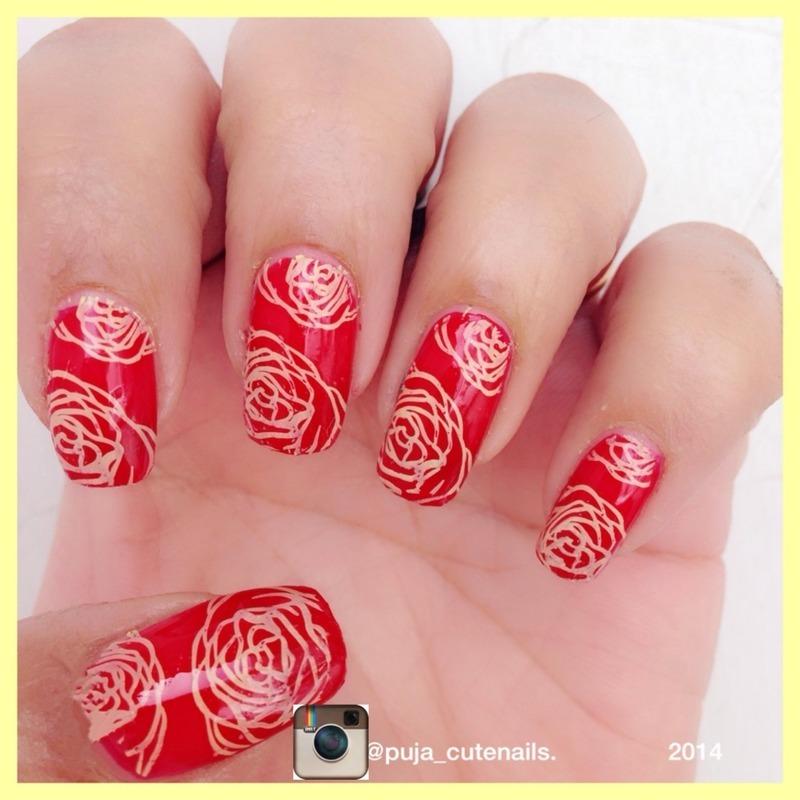 Yellow roses over red nail art nail art by Puja Malhotra