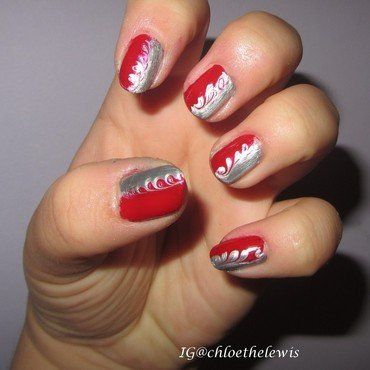Red and Silver Swirls nail art by Chloe Lewis