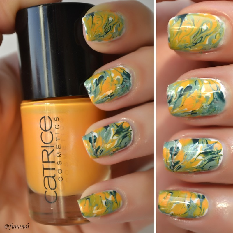 Dry marble nail art by Andrea  Manases
