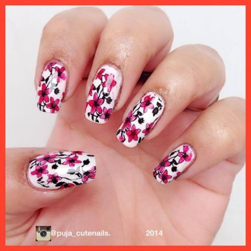 Red flowers nail art by Puja Malhotra