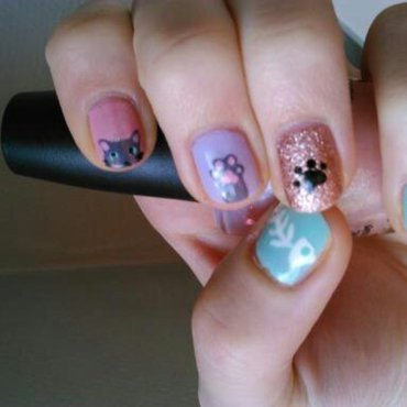 cute kitty (elle and ish model) nail art by manon des ours