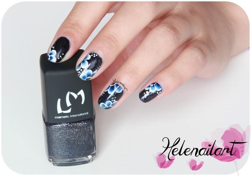 blue flower nail art by LÊ Hélène