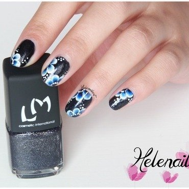 blue flower nail art by LÊ Hélène
