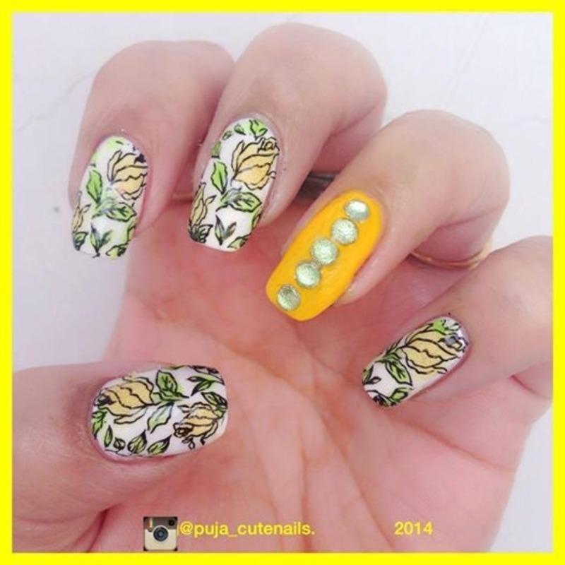 Yellow flowers nail art nail art by Puja Malhotra