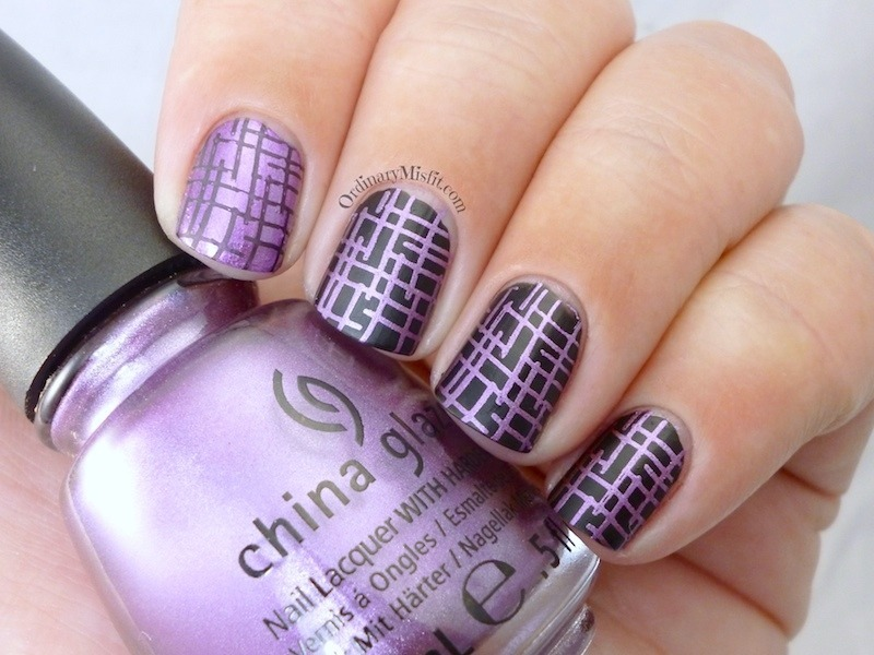 Purple on black nail art by Michelle