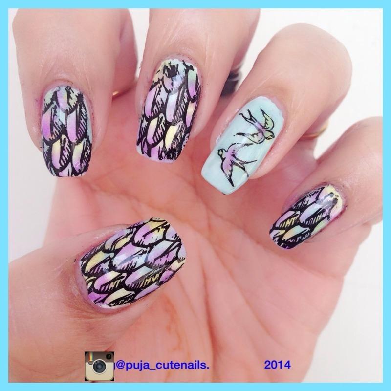 Birds and feathers nail art nail art by Puja Malhotra