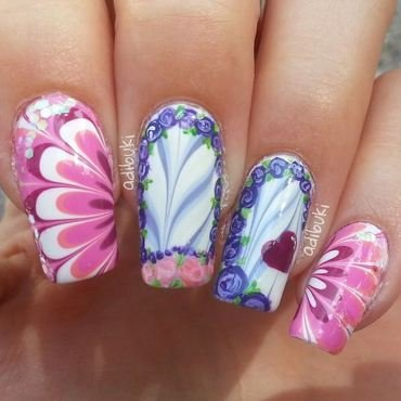 Floral watermarble nail art by Adi Buki