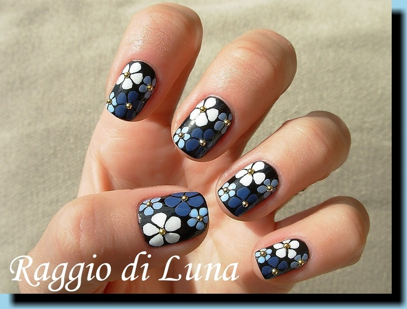 Blue and white flowers on black nail art by Tanja