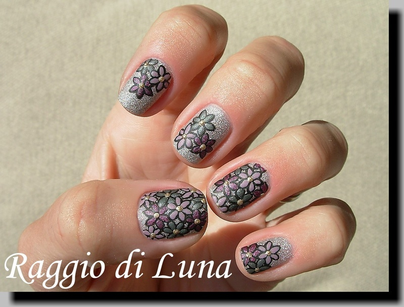 Flowers on silver holo nail art by Tanja