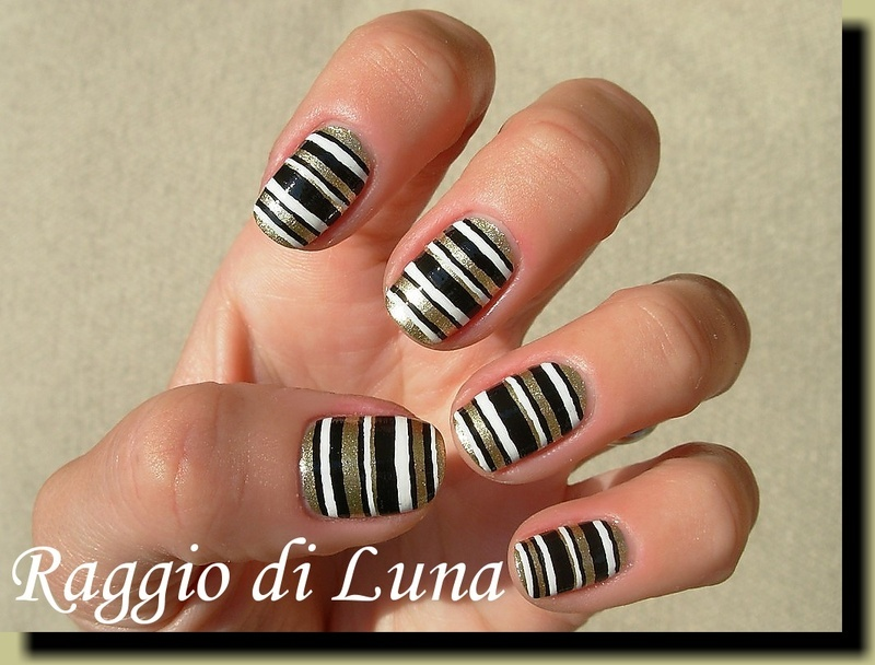Horizontal stripes golden & black & white nail art by Tanja