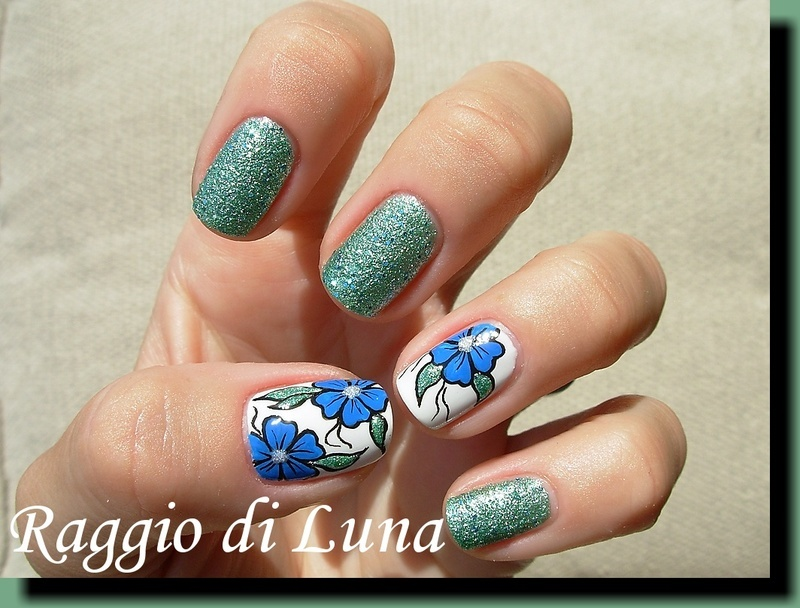 Blue flower with textured green nail art by Tanja
