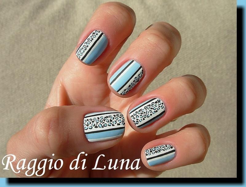 Leopard print on light blue nail art by Tanja